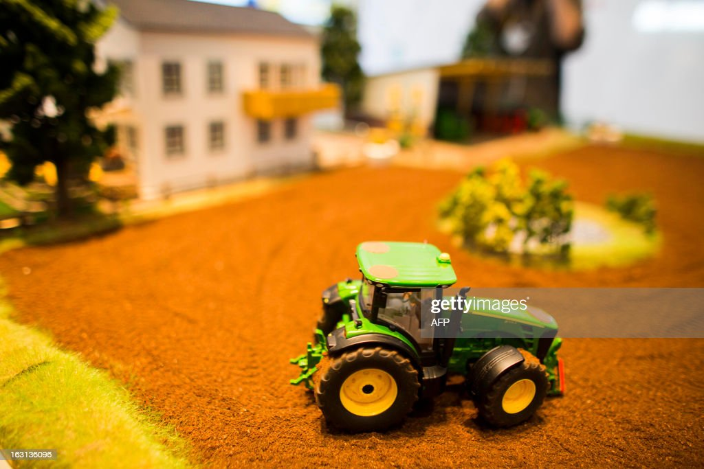 A model of electronically controlled tractor is seen during a demonstration at Fraunhofer institute stand at the 2013 CeBIT technology trade fair on March 5, 2013 in Hanover, Germany. CeBIT will be open March 5-9. AFP PHOTO / CARSTEN KOALL
