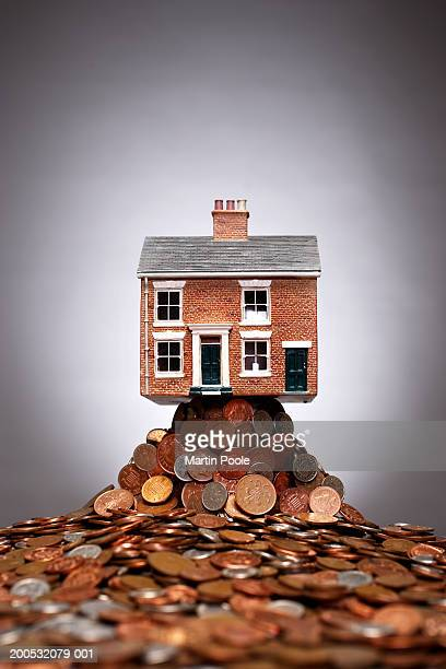 Model of house on pile of copper coins