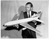 Model of Lockheed's proposed new large luxury jetliner the L1011 is held by Rovert Baily LockheedCalifornia Company vice president and program...