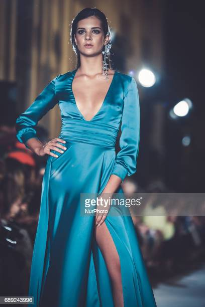 Model of Maria Jose Sarez walks on the catwalk in Seville on May 26 2017