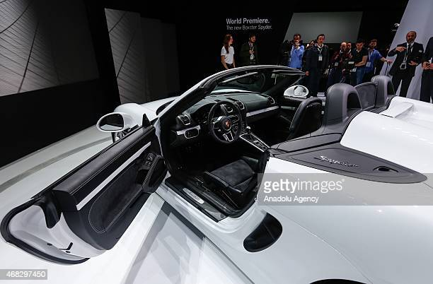 A model of Porsche is displayed during the New York International Auto Show in New York on April 1 2015 The press preview days of New York...