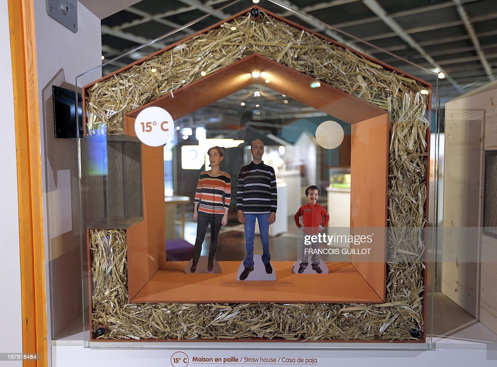 A model of straw house is displayed at the Cite des Sciences et de l'Industrie in Paris on December 4, 2012, as part of the exhibition 'Habiter demain' (Reinventing our homes) focused on the social and human aspects of housing and the new way to build home of the future and renovate houses. The event runs from December 4, 2012 to November 13, 2013.