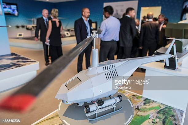 A model of the Airbus Defence Space Tanan 300 vertical takeoff and landing unmanned aircraft manufactured by Airbus Group NV stands on display during...