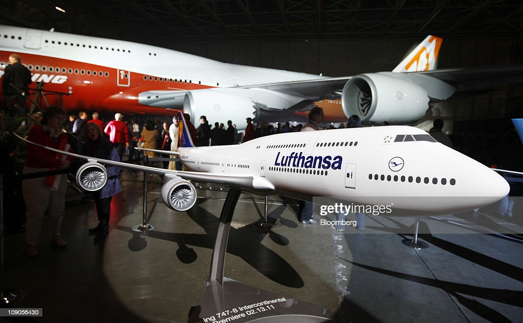 A model of the Boeing Co. 747-8 Intercontinental in Lufthansa livery is shown as the jumbo jet is rolled out at Boeing's manufacturing facility in Everett, Washington, U.S., on Sunday, Feb. 13, 2011. Boeing aims for the passenger version of the delayed 747-8 shown to customers and investors today to fly for the first time in March, a little more than a year after the freighter variant. Photographer: Kevin P. Casey/Bloomberg via Getty Images