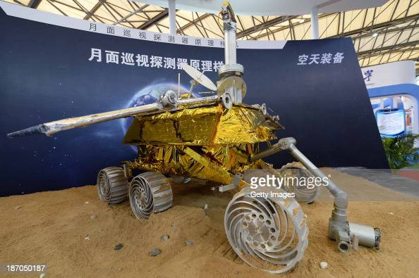 A model of the Chang'e3 lunar rover is on display during the China International Industry Fair 2013 at Shanghai New International Expo Centre on...