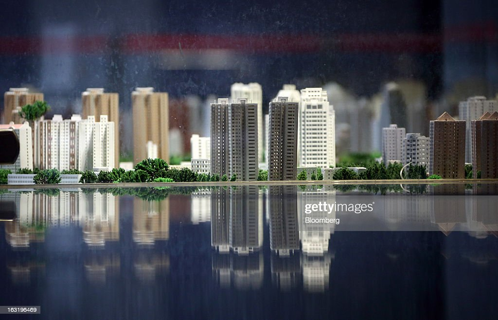 A model of the city of Beijing is displayed at the Beijing Planning Exhibition Hall in Beijing, China, on Wednesday, March 6, 2013. China maintained its economic-growth target at 7.5 percent for 2013 while setting a lower inflation goal of 3.5 percent, setting up a challenge for new leaders to keep prices in check without harming expansion. Photographer: Tomohiro Ohsumi/Bloomberg via Getty Images