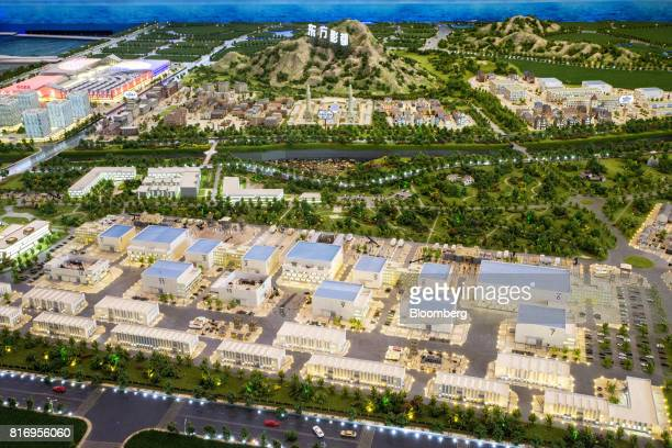 A model of the Dalian Wanda Group Co Oriental Movie Metropolis stands at a real estate showroom inside the project site in Qingdao China on Saturday...