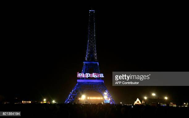 A model of the Eiffel Tower is seen at night during the Lollapalooza music festival at the Longchamp Hippodrome in Paris on July 23 2017 / AFP PHOTO...
