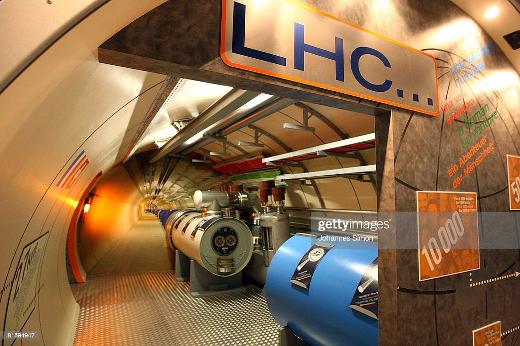 A model of the Large Hadron Collider (LHC) tunnel is seen in the CERN (European Organization For Nuclear Research) visitors' center June 16, 2008 in Geneva-Meyrin, Switzerland. CERN is building the world's biggest and most powerful particle accelerator. The LHC is being installed in a tunnel 27 kilometers in circumference, buried 50 - 150 meters below ground. It will provide collisions at the highest energies ever observed in laboratory conditions. Four huge detectors - ALICE, ATLAS, CMS and LHCB - will observe the collisions so that the physicists can explore new territory in matter, energy, space and time.