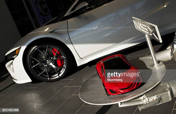 A model of the new Honda Motor Co 2017 Acura NSX vehicle sits on display in the showroom at the Honda Performance Manufacturing Center in Marysville...