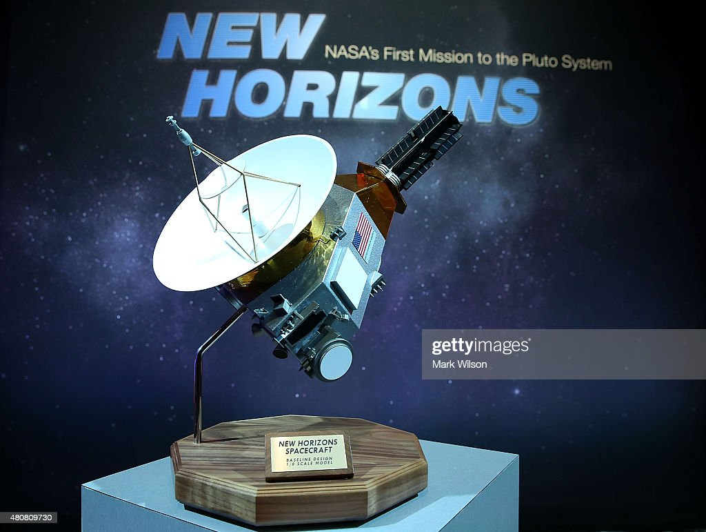 A model of the New Horizons spacecraft that passed with 7800 miles of Pluto yesterday is on display at a NASA news conference July 15 2015 in Laurel...