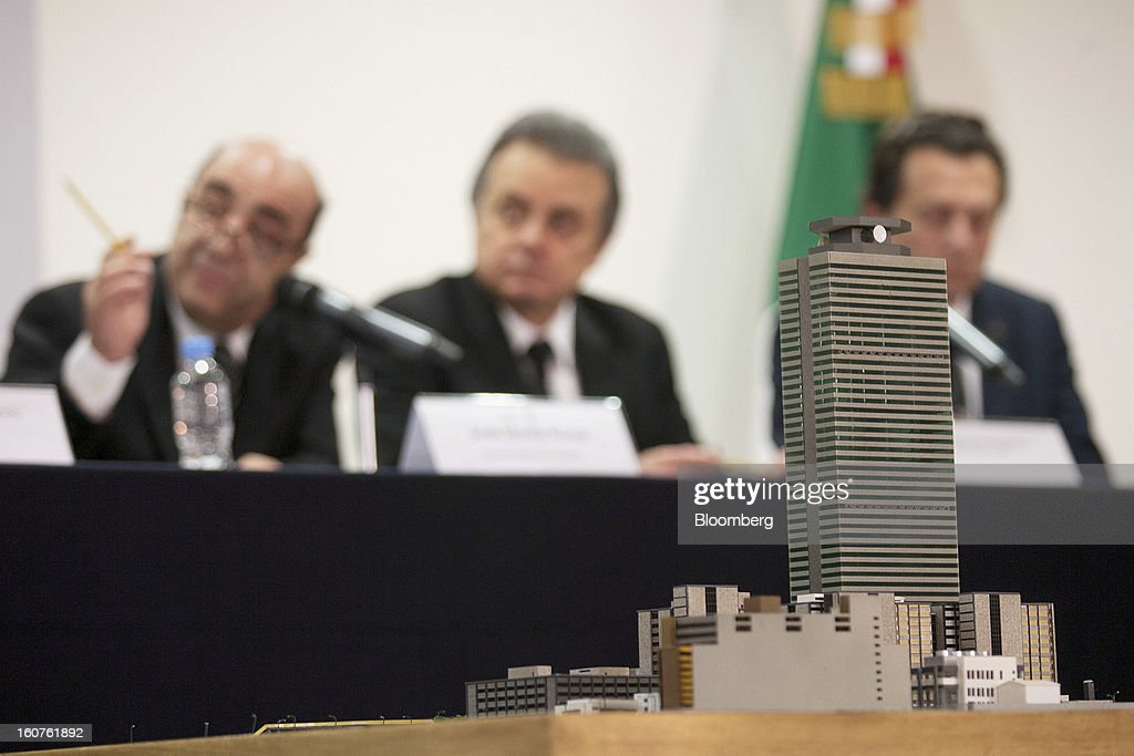 A model of the Petroleos Mexicanos (Pemex) administrative building sits in the foreground while Jesus Murillo Karam, Mexico's attorney general, from left, Pedro Joaquin Coldwell, energy minister, and Emilio Lozoya Austin, chief executive officer of Pemex, hold a news conference in Mexico City, Mexico, on Monday, Feb. 4, 2013. The blast that killed 37 people at state-owned oil company Petroleos Mexicanos's headquarters in Mexico City last week was caused by gas buildup, Murillo said, the first government explanation for the nation's deadliest explosion since 2006. Photographer: Susana Gonzalez/Bloomberg via Getty Images