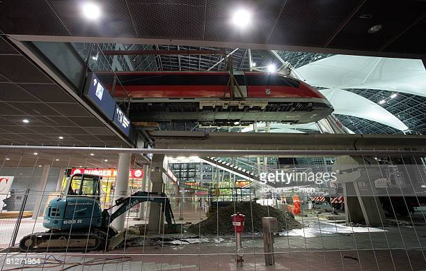 A model of the Transrapid magnetic levitation train is taken down from display at the Munich Airport on May 28 2008 in Munich Germany Officials of...