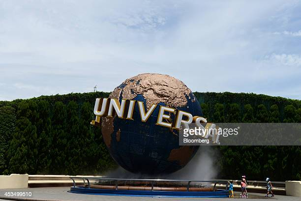 A model of the Universal Studios logo is displayed at the entrance to the Universal Studios Japan operated by USJ Co in Osaka Japan on Thursday Aug 7...
