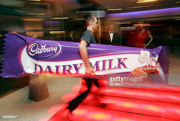 A model of the world's largest Cadbury Dairy Milk Bar is unveiled as part of Cadbury Dairy Milk's centenary celebrations at Madame Tussauds on...