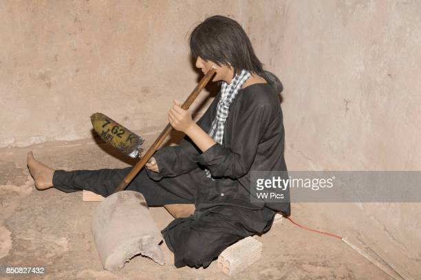 Model of Vietnamese person whittling Ben Dinh Cu Chi near Ho Chi Minh City Vietnam