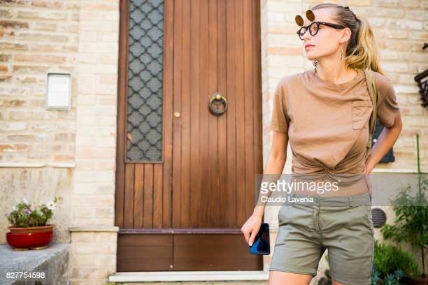 Model Olga de Mar wears Cosplay vintage sunglasses Bershka earings Dani top and shorts on August 6 2017 in Porto San Giorgio Italy