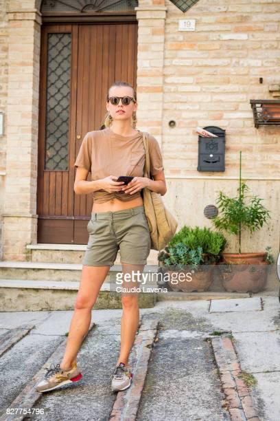 Model Olga de Mar wears Cosplay vintage sunglasses Bershka earings Dani top and shorts Formentera vintage bag and Drunknmunky shoes on August 6 2017...