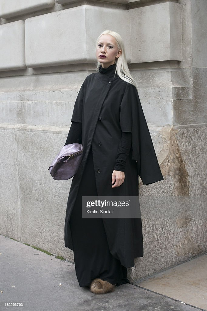 Model Olimpia Whitemustache wears a Malloni jacket, Bessariun shoes, vintage bag and Poustovit dress on day 5 of Paris Fashion Week Spring/Summer 2014, Paris September 28, 2013 in Paris, France.