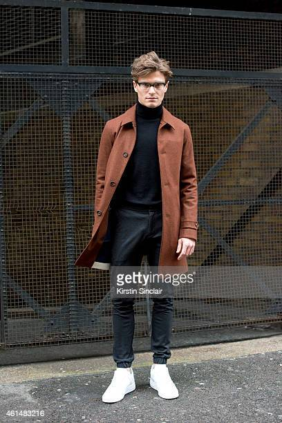 Model Oliver Cheshire wearing Nike Air Force One trainers Top Man Trousers Marks and Spencers jumper aquascutum jacket Vintage glasses on day 4 of...