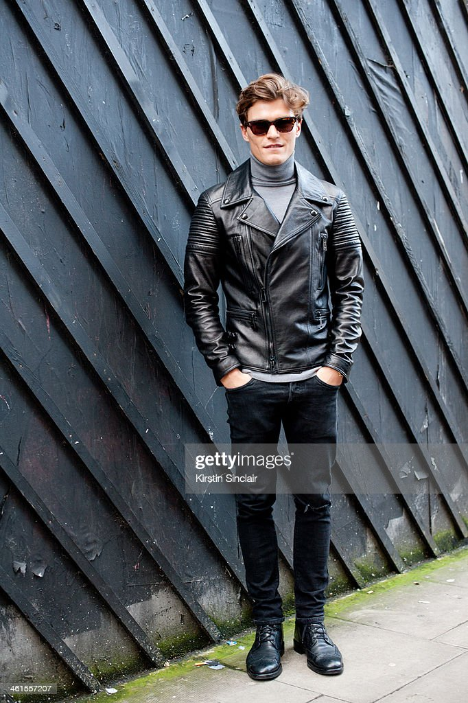Model <a gi-track='captionPersonalityLinkClicked' href=/galleries/search?phrase=Oliver+Cheshire&family=editorial&specificpeople=7407100 ng-click='$event.stopPropagation()'>Oliver Cheshire</a> wears a Belstaff jacket, H and M jeans, Russell and Bromley shoes, Cos top and Eye Respect sunglasses day 3 of London Mens Fashion Week Autumn/Winter 2014, on January 08, 2014 in London, England.