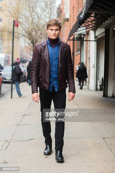 Model Oliver Cheshire wears a Diesel Black Gold jacket Uniqlo shirt Levi jeans and Russell Bromley boots at Streets of Manhattan on February 12 2015...