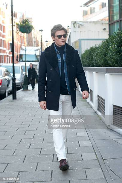 Model Oliver Cheshire wears a Private White suit Levis denim jacket Hackett top Uniqlo trousers Dita sunglasses and Marks and Spencer shoes on day 1...
