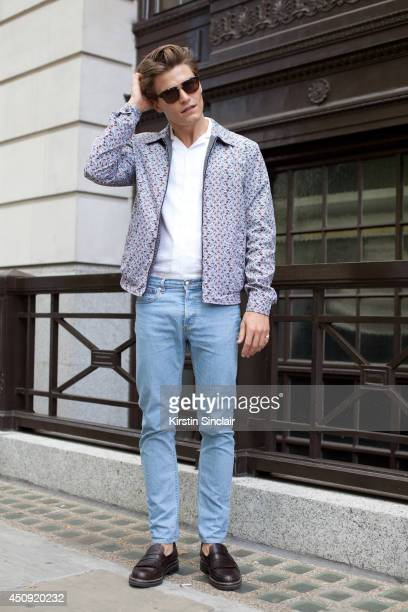 Model Oliver Cheshire wears APC jeans Dolce and Gabbana jacket Reiss shirt Zegna shoes and EyeRespect sunglasses on day 3 of London Collections Men...