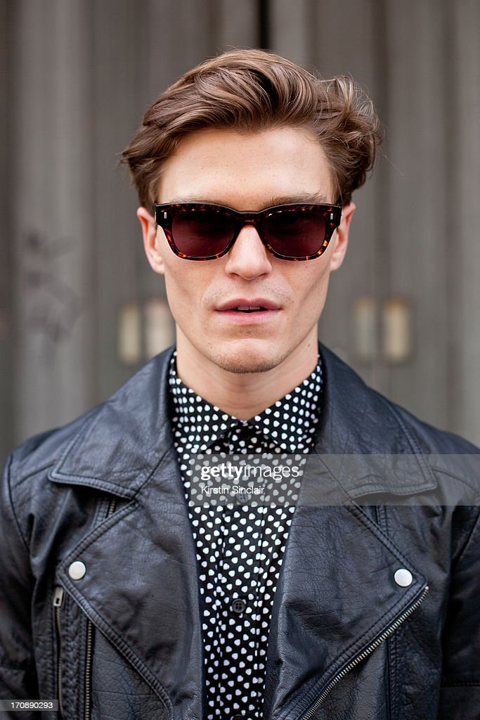 Model Oliver Cheshire wears Yves Saint Laurent jacket, and Reiss top on day 3 of London Collections: Men on June 18, 2013 in London, England.