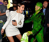 Model Olivia Culpo and host Nick Jonas after getting slimed backstage during Nickelodeon's 28th Annual Kids' Choice Awards held at The Forum on March...