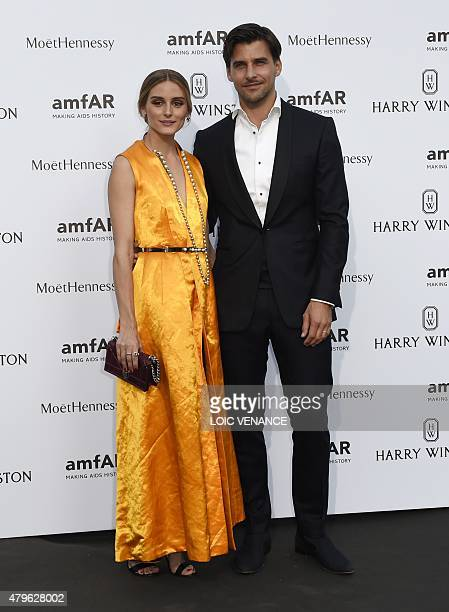US model Olivia Palermo and her husband Johannes Huebl pose as they arrive for the amfAR dinner on the sidelines of the Paris fashion week in Paris...