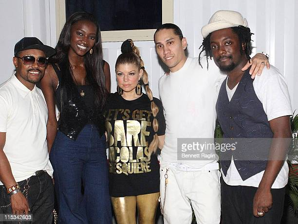 Model Oluchi Onweagba poses with Recording artist Black Eyed Peas for a picture backstage at the Black Eye Peas concert THISDAY Arena October 14...