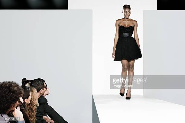 Model on catwalk at fashion show