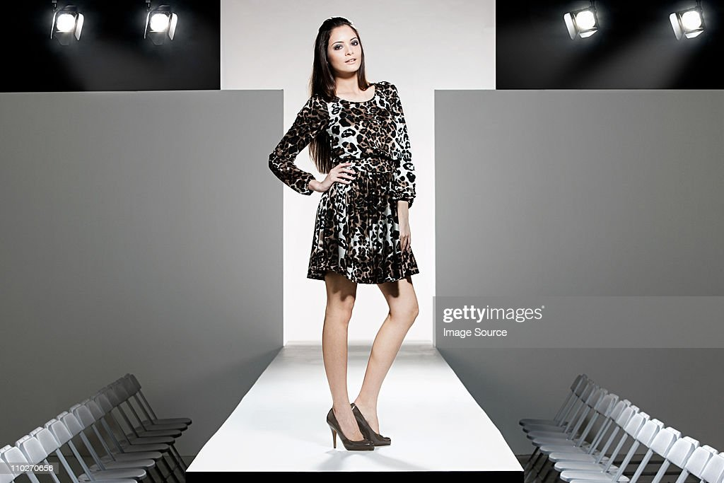 Model on catwalk at fashion show : Stock Photo