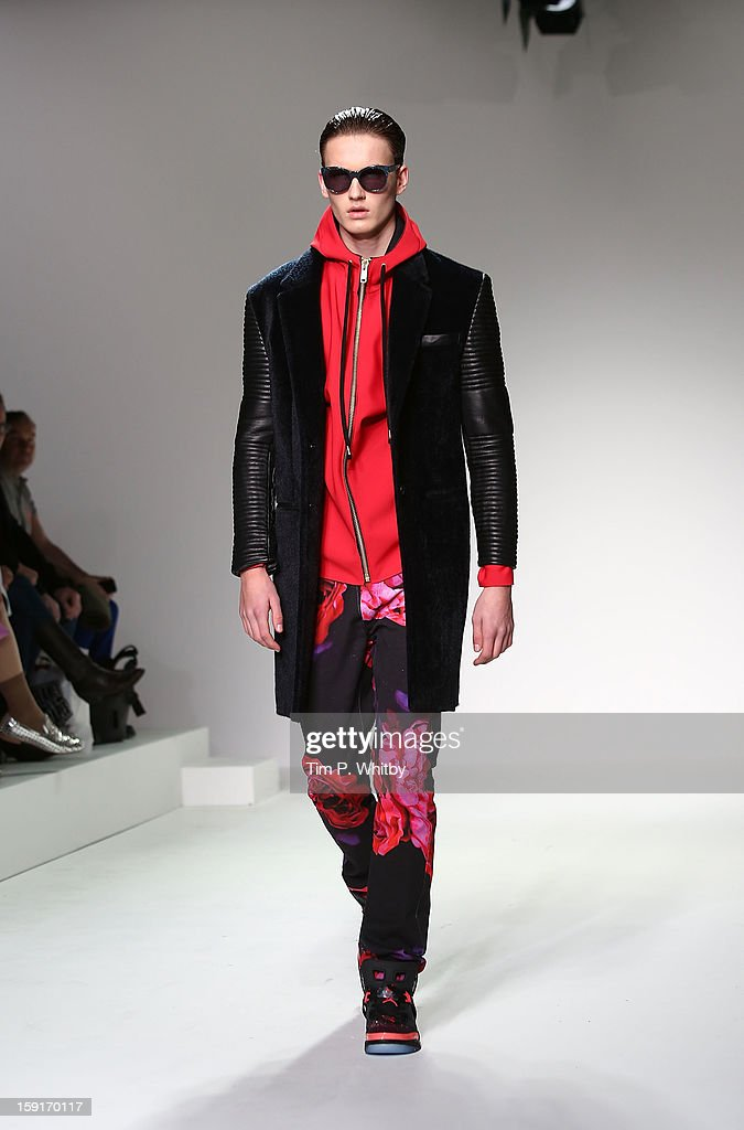 A model on the catwalk during the Katie Eary show at the London Collections: MEN AW13 at The Hospital Club on January 9, 2013 in London, England.