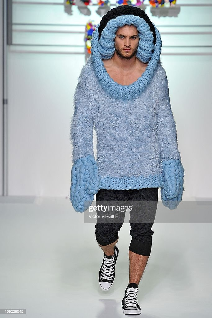 A model on the catwalk during the Sibling Ready to wear Fall/Winter 2013-2014 show at the London Collections: MEN AW13 at The Hospital Club on January 8, 2013 in London, England.