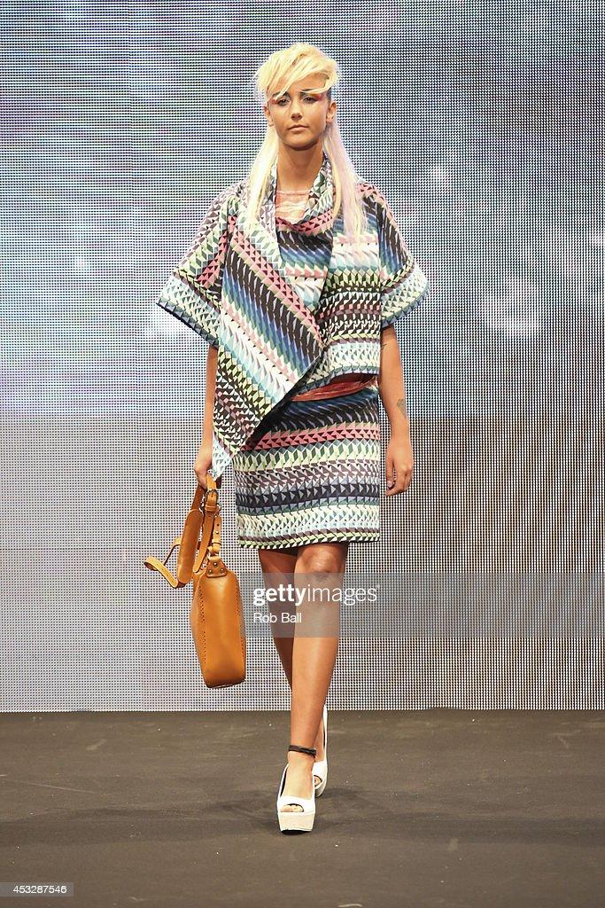 A model on the catwalk for Finish designer 2OR+BYYAT at Copenhagen Fashion Week on August 6, 2014 in Copenhagen, Denmark.
