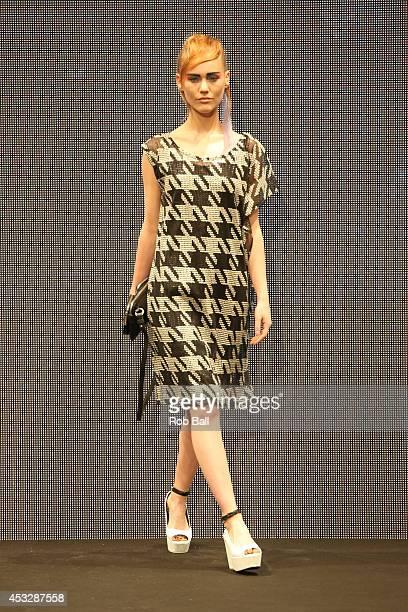A model on the catwalk for Finish designer 2ORBYYAT at Copenhagen Fashion Week on August 6 2014 in Copenhagen Denmark