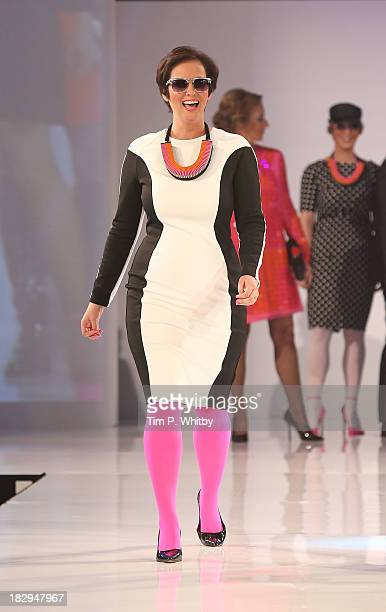 Model on the runway at the afternoon performance of the Breast Cancer Care Fashion Show at Grosvenor House on October 2 2013 in London England