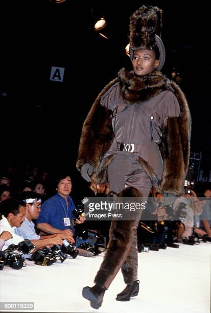 A model on the runway at the Issey Miyake Fall1990 fashion show circa 1990 in Paris France