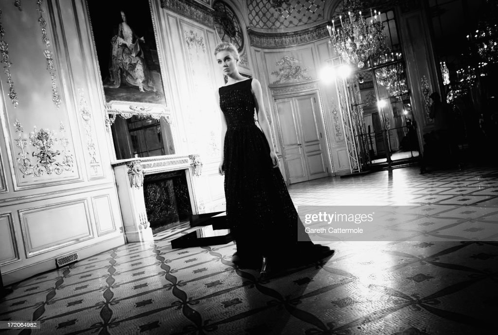 A model on the runway during the Rami Al Ali show as part of Paris Fashion Week Haute-Couture Fall/Winter 2013-2014 on July 1, 2013 at the Le Meurice Salon Pompadour in Paris, France.
