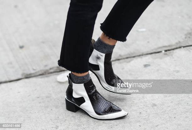 Model Ophelie Guillermand is seen wearing black and white shoes outside of the ROCHAMBEAU show during New York Fashion Week Men's AW17 on February 1...