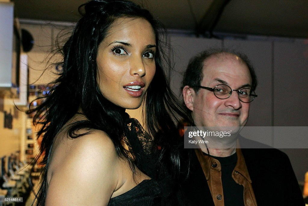 Model Padma Lakshmi and Writer Salman Rushdie pose for photos in the lobby of the main tent during Olympus Fashion Week Fall 2005 at Bryant Park February 6, 2005 in New York City.