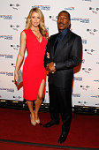 Model Paige Butcher and Mark Twain prize honoree Eddie Murphy attend the 18th Annual Mark Twain Prize for Humor at The John F Kennedy Center for...