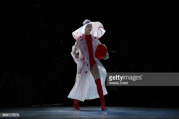 TOPSHOT A model parades a creation designed by Young Designers from BIFTMMUSCU at China Fashion Week in Beijing on March 27 2017 / AFP PHOTO / WANG...