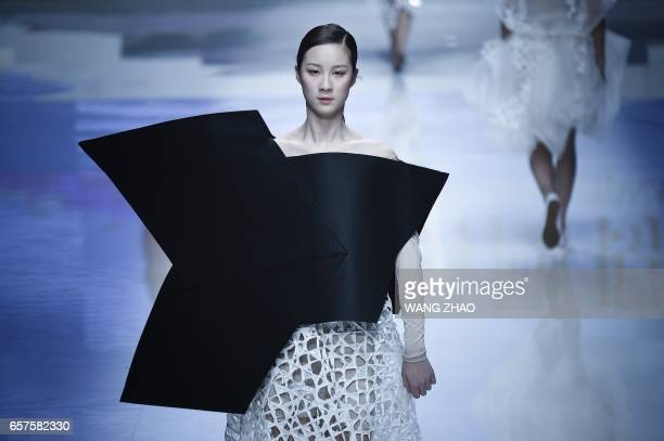 TOPSHOT A model parades a creation during the 'Hempel Award' for the 25th China International Young Fashion Designers Contest after the opening...