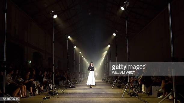 TOPSHOT A model parades a creation from Australian label Aje during a showing of their new collection at Fashion Week Australia in Sydney on May 16...