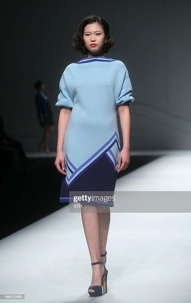 A model parades a creation from the CHUHETINGXIANG Chu Yan Collection during China Fashion Week in Beijing on October 31, 2013. China Fashion Week runs from October 25 to November 1. CHINA