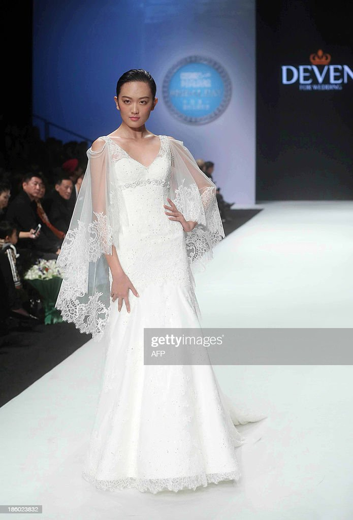A model parades a creation from the Deven Wedding Dress Collection during the China Fashion Week in Beijing on October 27, 2013. China Fashion Week runs from October 25 to November 1. CHINA