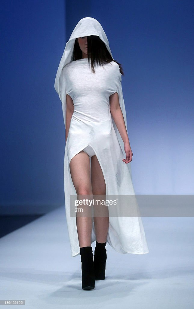 A model parades a creation from the Just For Tee Zhang Beiyong Collection during China Fashion Week in Beijing on October 31, 2013. China Fashion Week runs from October 25 to November 1. CHINA